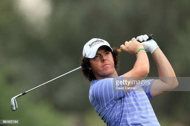 Rory McIlroy of Northern Ireland plays his second shot at the 16th hole during the third round of the 2010 Omega Dubai Desert Classic on the Majilis...