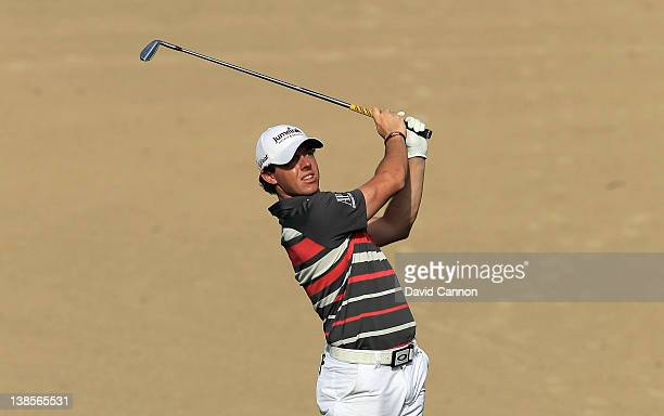Rory McIlroy of Northern Ireland plays his second shot at the par 4 14th hole during the first round of the 2012 Omega Dubai Desert Classic on the...