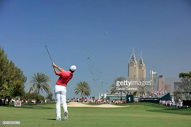 Rory McIlroy of Northern Ireland plays his second shot at the par 4 first hole during the second round of the 2016 Omega Dubai Desert Classic on the...