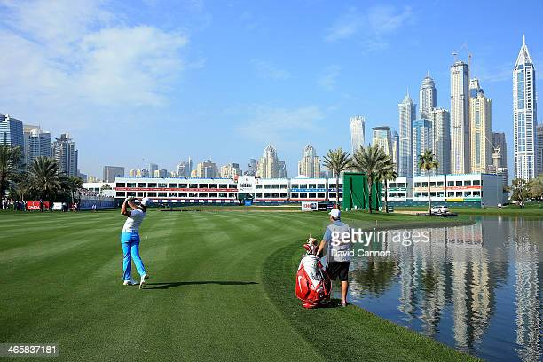 Rory McIlroy of Northern Ireland plays his second shot at the par 5, 18th hole during the first round of the 2014 Omega Dubai Desert Classic on the...