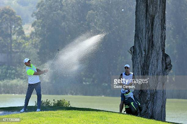 Rory McIlroy of Northern Ireland plays his second shot from a bunker on the 12th hole during round two of the World Golf Championship Cadillac Match...