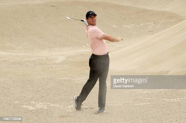 Rory McIlroy of Northern Ireland plays his second shot from a deep fairway bunker on the par 4 third hole during the third round of the DP World Tour...
