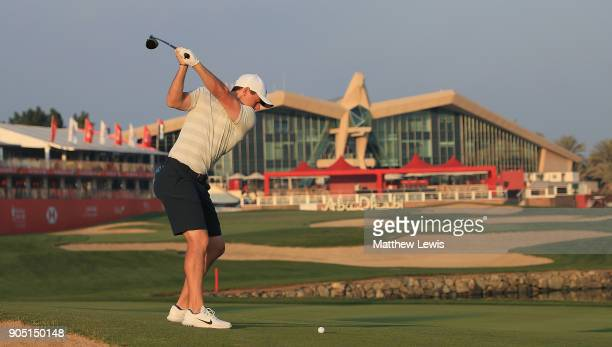 Rory McIlroy of Northern Ireland plays his second shot from the 18th fairway during a practice round ahead of Abu Dhabi HSBC Golf Championship at Abu...