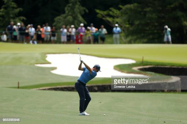 Rory McIlroy of Northern Ireland plays his second shot from the seventh fairway during the final round of the 2018 Wells Fargo Championship at Quail...
