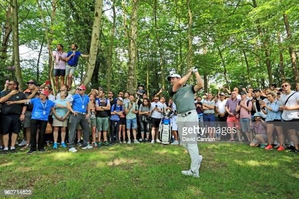 Rory McIlroy of Northern Ireland plays his second shot from the trees on the par 4 third hole during the third round of the 2018 BMW PGA Championship...
