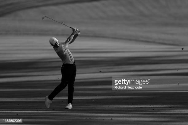 Rory McIlroy of Northern Ireland plays his second shot on the 11th hole during the first round of The PLAYERS Championship on The Stadium Course at...