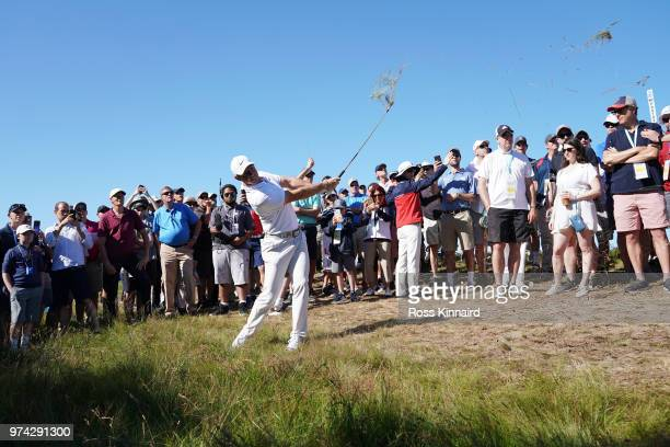 Rory McIlroy of Northern Ireland plays his second shot on the 12th hole during the first round of the 2018 US Open at Shinnecock Hills Golf Club on...