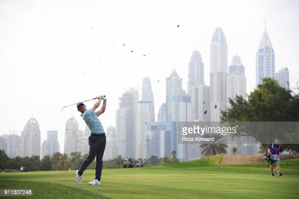 Rory McIlroy of Northern Ireland plays his second shot on the 13th hole during the final round on day four of the Omega Dubai Desert Classic at...