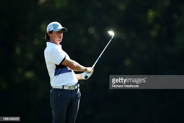 Rory McIlroy of Northern Ireland plays his second shot on the 14th hole during round one of THE PLAYERS Championship at THE PLAYERS Stadium course at...