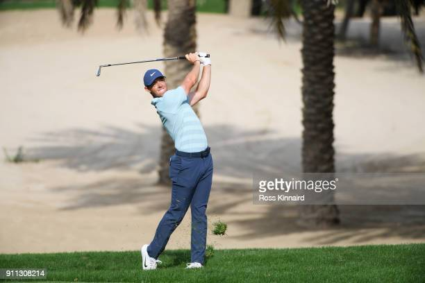 Rory McIlroy of Northern Ireland plays his second shot on the 14th hole during the final round on day four of the Omega Dubai Desert Classic at...