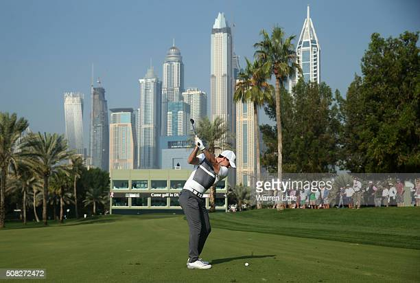 Rory McIlroy of Northern Ireland plays his second shot on the 16th hole during the first round of the Omega Dubai Desert Classic at The Emirates Golf...