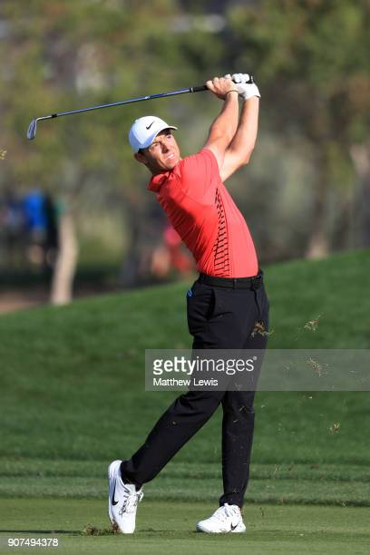 Rory McIlroy of Northern Ireland plays his second shot on the 16th hole during round three of the Abu Dhabi HSBC Golf Championship at Abu Dhabi Golf...