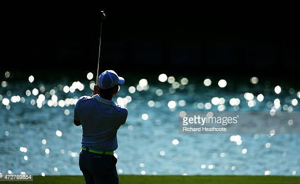 Rory McIlroy of Northern Ireland plays his second shot on the 18th hole during round three of THE PLAYERS Championship at the TPC Sawgrass Stadium...