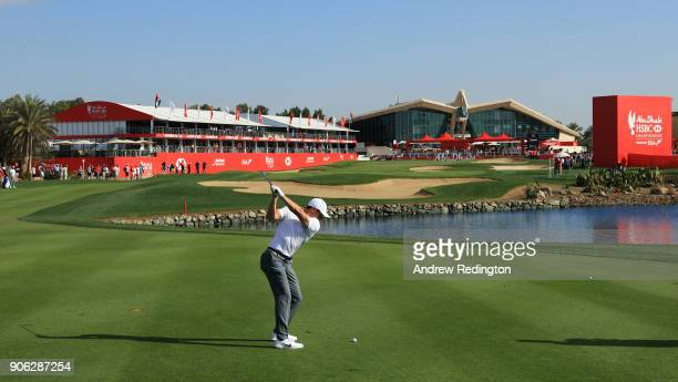 Rory McIlroy of Northern Ireland plays his second shot on the 18th hole during round one of the Abu Dhabi HSBC Golf Championship at Abu Dhabi Golf...
