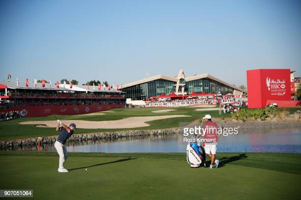 Rory McIlroy of Northern Ireland plays his second shot on the 18th hole during round two of the Abu Dhabi HSBC Golf Championship at Abu Dhabi Golf...