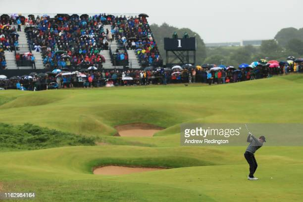 Rory McIlroy of Northern Ireland plays his second shot on the 1st hole during the second round of the 148th Open Championship held on the Dunluce...