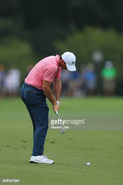 Rory McIlroy of Northern Ireland plays his second shot on the fifth hole during a practice round prior to the 2017 PGA Championship at Quail Hollow...