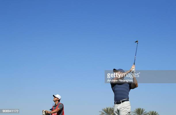 Rory McIlroy of Northern Ireland plays his second shot on the first hole during round two of the Abu Dhabi HSBC Golf Championship at Abu Dhabi Golf...