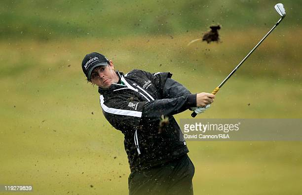 Rory McIlroy of Northern Ireland plays his second shot on the ninth hole during the third round of The 140th Open Championship at Royal St George's...