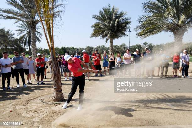 Rory McIlroy of Northern Ireland plays his second shot on the ninth hole during round three of the Abu Dhabi HSBC Golf Championship at Abu Dhabi Golf...