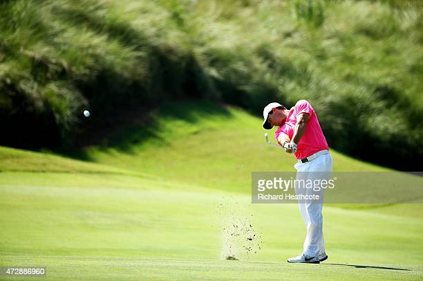 Rory McIlroy of Northern Ireland plays his second shot on the on the 16th hole during the final round of THE PLAYERS Championship at the TPC Sawgrass...