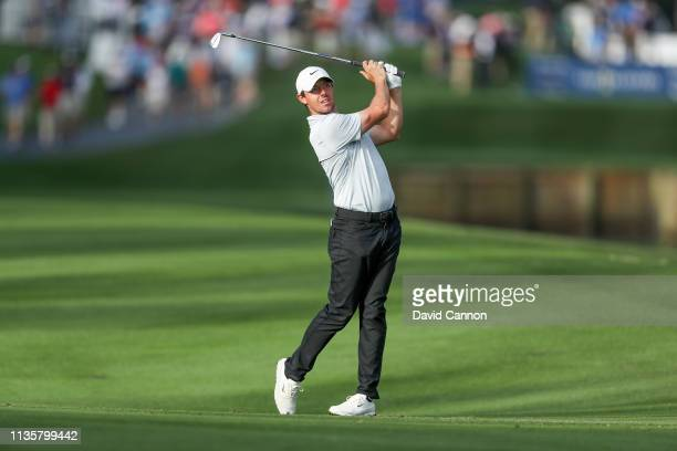 Rory McIlroy of Northern Ireland plays his second shot on the par 4, 10th hole during the first round of the 2019 Players Championship held on the...