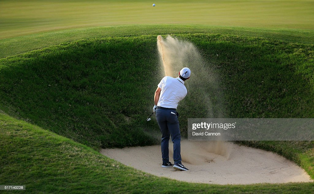 Rory McIlroy of Northern Ireland plays his second shot on the par 4, 18th hole in his match against Throbjprn Olesen of Denmark during the first round of the 2016 World Golf Championships Dell Match Play at The Austin Country Club on March 23, 2016 in Austin, Texas.