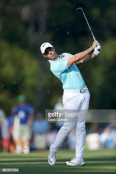Rory McIlroy of Northern Ireland plays his second shot on the par 4, 10th hole during the second round of THE PLAYERS Championship on the Stadium...