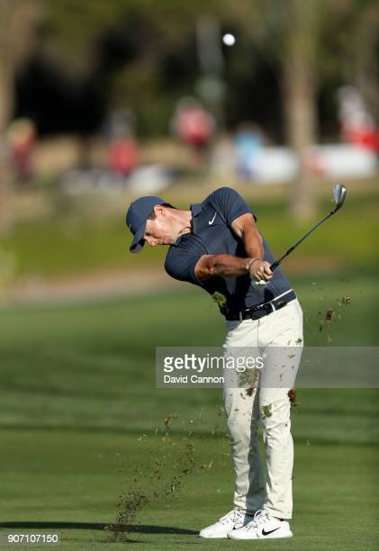 Rory McIlroy of Northern Ireland plays his second shot on the par 4, 16th hole during the second round of the 2018 Abu Dhabi HSBC Golf Championship...