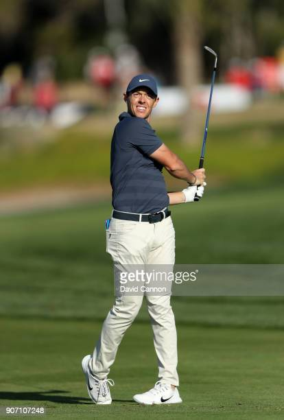 Rory McIlroy of Northern Ireland plays his second shot on the par 4 16th hole during the second round of the 2018 Abu Dhabi HSBC Gof Championship at...