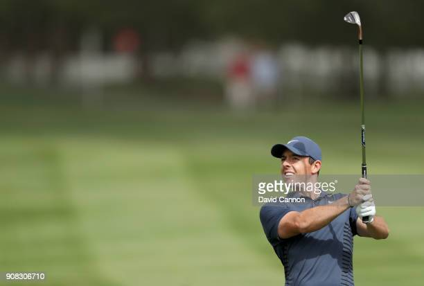 Rory McIlroy of Northern Ireland plays his second shot on the par 4 first hole during the final round of the Abu Dhabi HSBC Golf Championship at Abu...