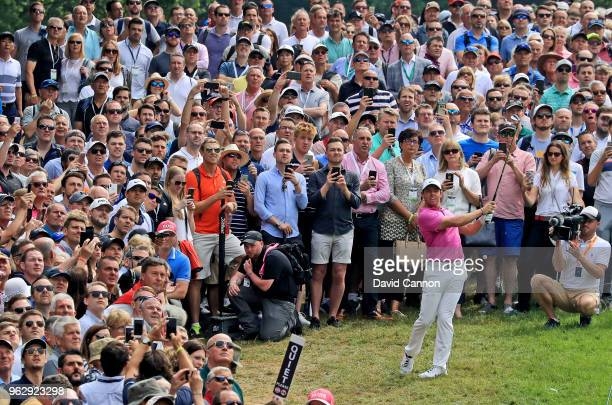 Rory McIlroy of Northern Ireland plays his second shot on the par 4 first hole during the final round of the 2018 BMW PGA Championship on the West...