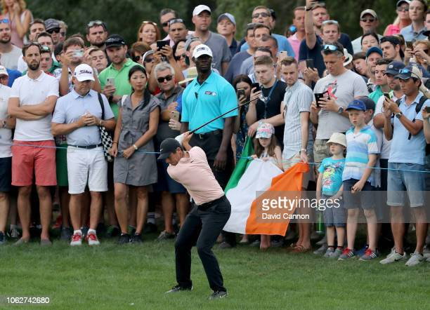 Rory McIlroy of Northern Ireland plays his second shot on the par 5, 18th hole during the third round of the DP World Tour Championship on the Earth...