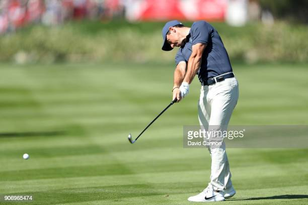 Rory McIlroy of Northern Ireland plays his second shot on the par 5 second hole during the second round of the 2018 Abu Dhabi HSBC Gof Championship...
