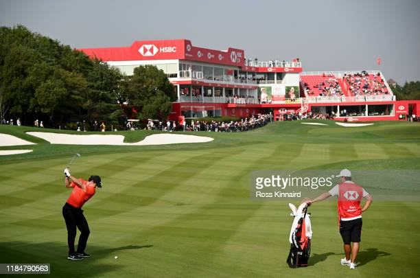 Rory McIlroy of Northern Ireland plays his second shot on the par five 18th hole during the second round of the WGC HSBC Champions at Sheshan...