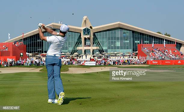 Rory McIlroy of Northern Ireland plays his second shot on the par four 9th hole during the second round of the Abu Dhabi HSBC Golf Championship at...