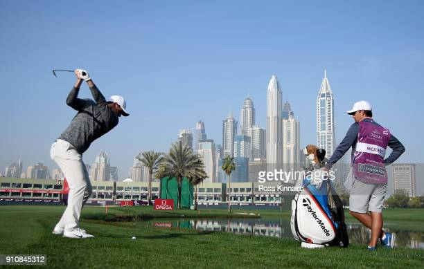 Rory McIlroy of Northern Ireland plays his second shot on the par five 18th hole during the continuation of the delayed second round of the Omega...