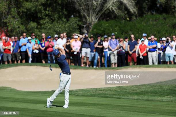 Rory McIlroy of Northern Ireland plays his second shot on the second hole during round two of the Abu Dhabi HSBC Golf Championship at Abu Dhabi Golf...