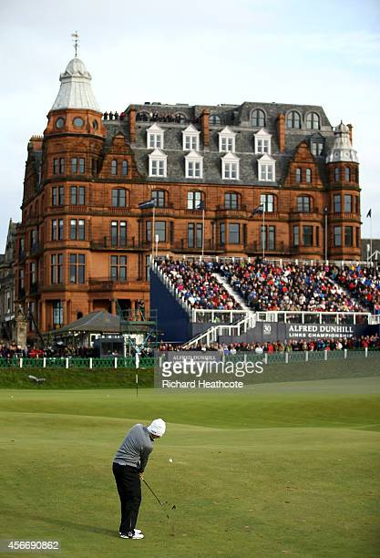 Rory McIlroy of Northern Ireland plays his second shot to the 18th green during the final round of the 2014 Alfred Dunhill Links Championship at The...