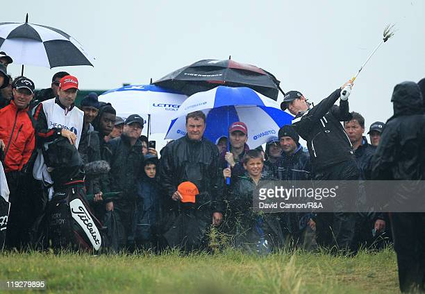 Rory McIlroy of Northern Ireland plays his second shot to the eighth green during the third round of The 140th Open Championship at Royal St George's...