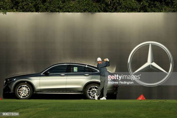 Rory McIlroy of Northern Ireland plays his shot from the 12th tee during round one of the Abu Dhabi HSBC Golf Championship at Abu Dhabi Golf Club on...