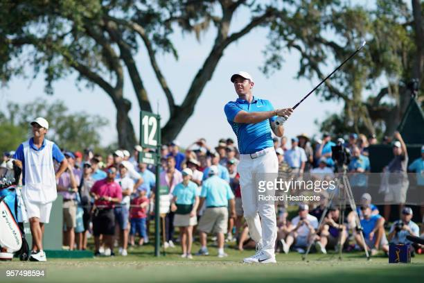 Rory McIlroy of Northern Ireland plays his shot from the 12th tee during the second round of THE PLAYERS Championship on the Stadium Course at TPC...