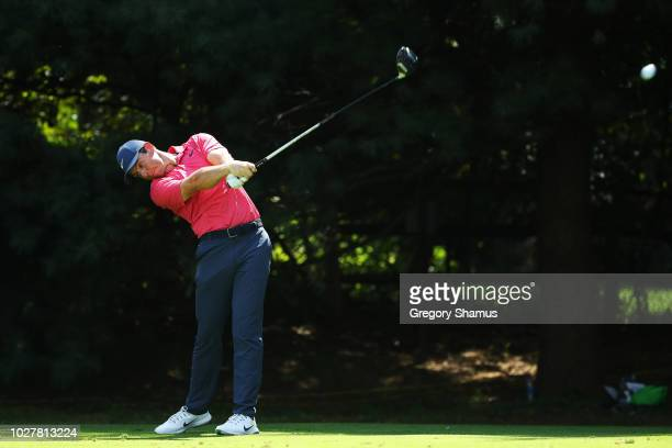 Rory McIlroy of Northern Ireland plays his shot from the 13th tee during the first round of the BMW Championship at Aronimink Golf Club on September...