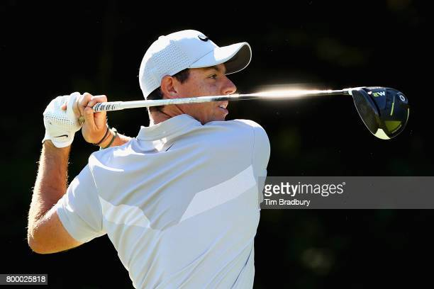 Rory McIlroy of Northern Ireland plays his shot from the 14th tee during the first round of the Travelers Championship at TPC River Highlands on June...