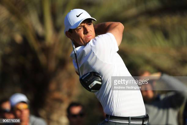 Rory McIlroy of Northern Ireland plays his shot from the 14th tee during round one of the Abu Dhabi HSBC Golf Championship at Abu Dhabi Golf Club on...
