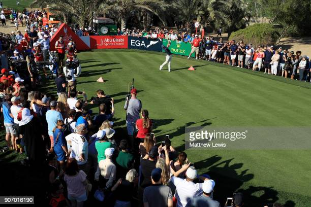 Rory McIlroy of Northern Ireland plays his shot from the 14th tee during round two of the Abu Dhabi HSBC Golf Championship at Abu Dhabi Golf Club on...