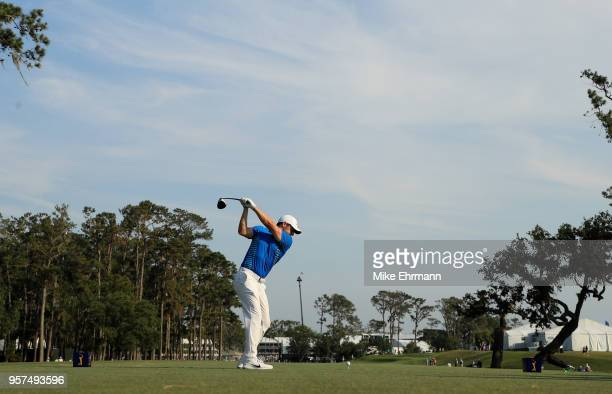 Rory McIlroy of Northern Ireland plays his shot from the 15th tee during the second round of THE PLAYERS Championship on the Stadium Course at TPC...