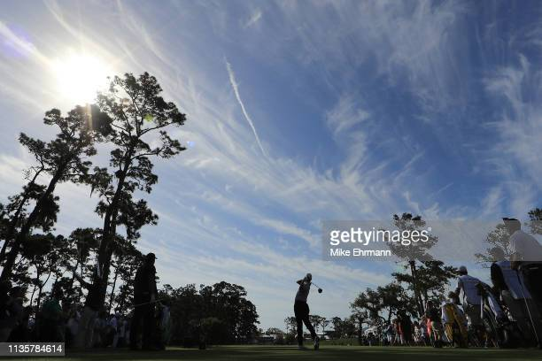 Rory McIlroy of Northern Ireland plays his shot from the 16th tee during the first round of The PLAYERS Championship on The Stadium Course at TPC...