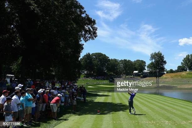 Rory McIlroy of Northern Ireland plays his shot from the 16th tee during the final round of the Travelers Championship at TPC River Highlands on June...