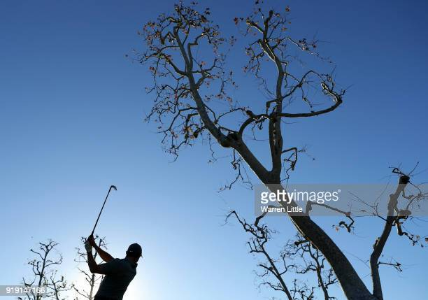 Rory McIlroy of Northern Ireland plays his shot from the 16th tee during the second round of the Genesis Open at Riviera Country Club on February 16...